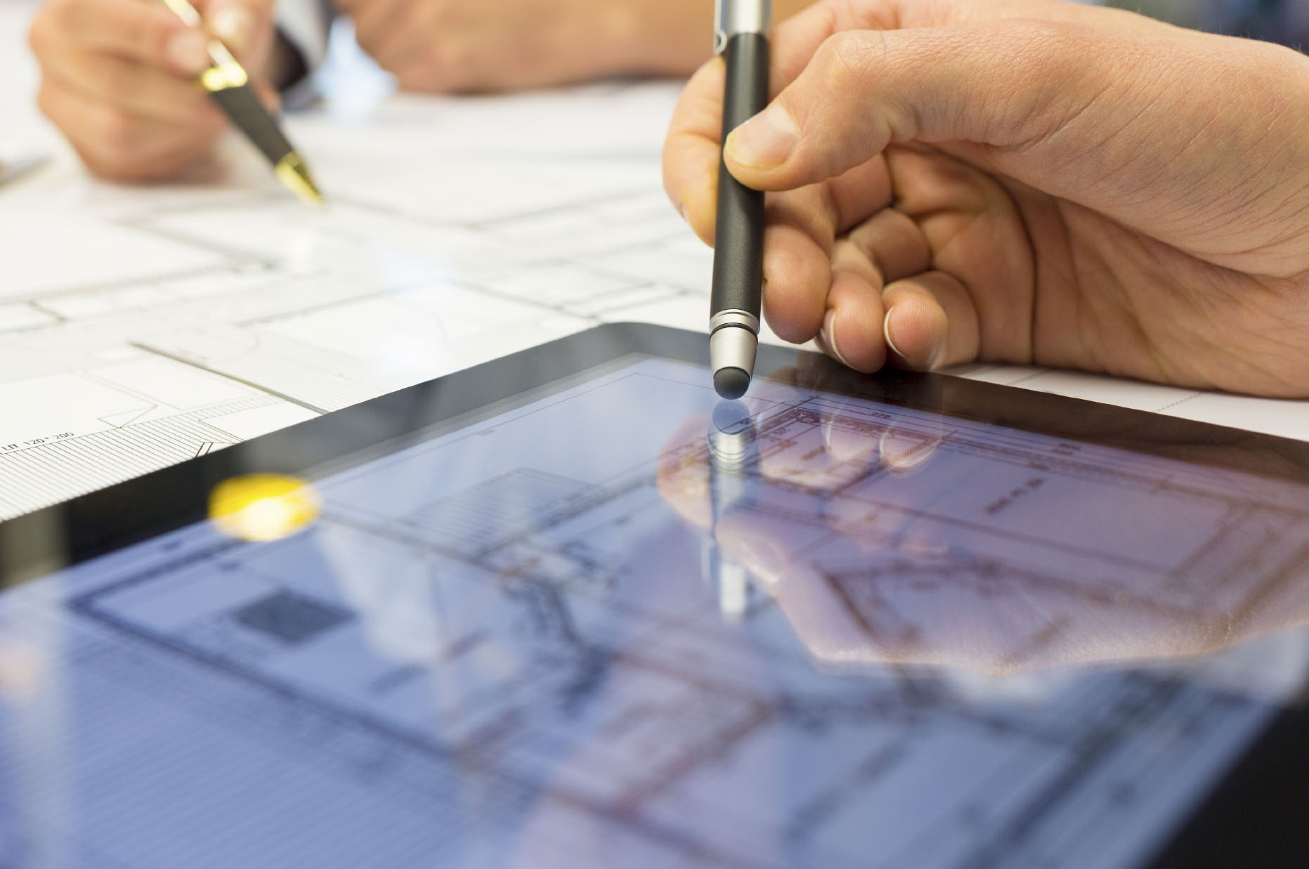 Architect viewing blueprints through the Board Papers app